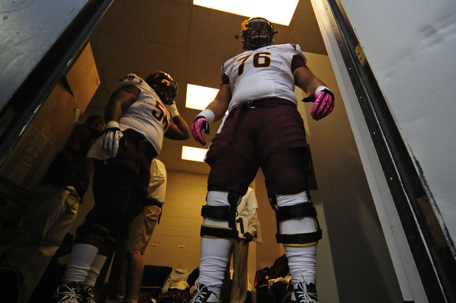 Oct 11 2012; Boulder, CO, USA; Arizona State Sun Devils offensive linesman Mo Latu (76) and linesman Devin Goodman (56) awaits to enter the field  before the start of the game against the Colorado Buffaloes at Folsom Field. Mandatory Credit: Ron Chenoy-US