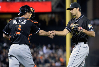 Steve Cishek receives a congratulatory handshake after picking up another save.