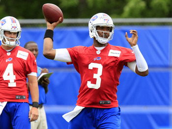 Jun 11, 2013; Buffalo, NY, USA; Buffalo Bills quarterback E.J. Manuel (3) passes the ball as quarterback Kevin Kolb (4) looks on during mini-camp at Ralph Wilson Stadium. Mandatory Credit: Kevin Hoffman-USA TODAY Sports