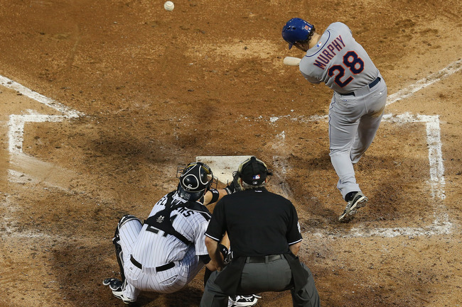 CHICAGO, IL - JUNE 26: Daniel Murphy #28 of the New York Mets hits a single in the 5th inning against the Chicago White Sox at U.S. Cellular Field on June 26, 2013 in Chicago, Illinois. (Photo by Jonathan Daniel/Getty Images)
