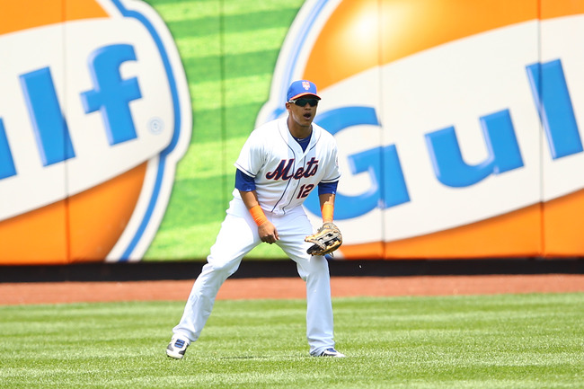 NEW YORK, NY - JUNE 15: Juan Lagares #12 of the New York Mets  in action against the during their game on June 15, 2013 at Citi Field in the Flushing neighborhood of the Queens borough of New York City.  (Photo by Al Bello/Getty Images)
