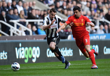 Newcastle defender Mathieu Debuchy tussles with former Magpies star Jose Enrique