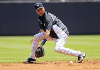 Jeter performing a baseball activity.