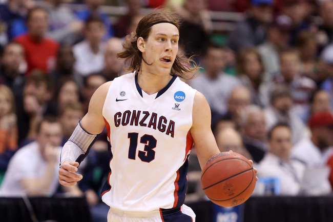 SALT LAKE CITY, UT - MARCH 23:  Kelly Olynyk #13 of the Gonzaga Bulldogs moves the ball in the first half while taking on the Wichita State Shockers during the third round of the 2013 NCAA Men's Basketball Tournament at EnergySolutions Arena on March 23,