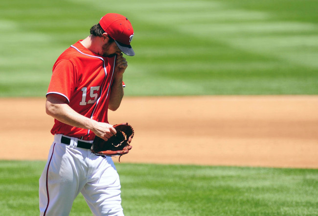 Jun 22, 2013; Washington, DC, USA; Washington Nationals pitcher Dan Haren (15) walks off the field after being taken out of the game in the fourth inning against the Colorado Rockies at Nationals Park. Mandatory Credit: Evan Habeeb-USA TODAY Sports