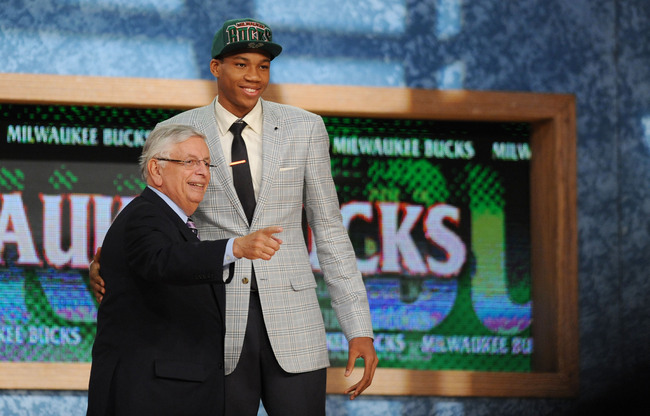 Jun 27, 2013; Brooklyn, NY, USA; Giannis Antetokounmpo poses for a photo with NBA commissioner David Stern after being selected as the number fifteen overall pick to the Milwaukee Bucks during the 2013 NBA Draft at the Barclays Center. Mandatory Credit: J