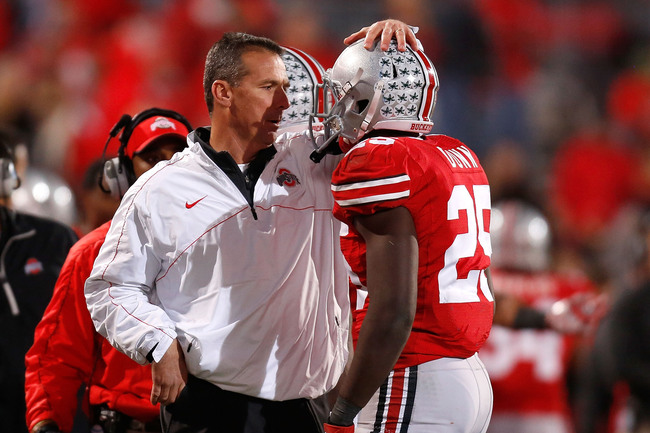 COLUMBUS, OH - NOVEMBER 03:  Head Coach Urban Meyer of the Ohio State Buckeyes congratulates Bri'onte Dunn #25 of the Ohio State Buckeyes after he scored a touchdown against the Illinois Illini on November 3, 2012 at Ohio Stadium in Columbus, Ohio. Ohio S