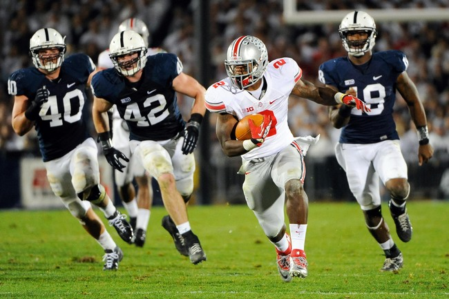 Oct 27, 2012; University Park, PA, USA; Ohio State Buckeyes running back Rod Smith (2) runs with the ball up field in front of a group of Penn State Nittany Lions defenders during the third quarter at Beaver Stadium.  Ohio State defeated Penn State 35-23.