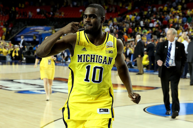 ATLANTA, GA - APRIL 06:  Tim Hardaway Jr. #10 of the Michigan Wolverines celebrates the Wolverines 61-56 victory against the Syracuse Orange during the 2013 NCAA Men's Final Four Semifinal at the Georgia Dome on April 6, 2013 in Atlanta, Georgia.  (Photo