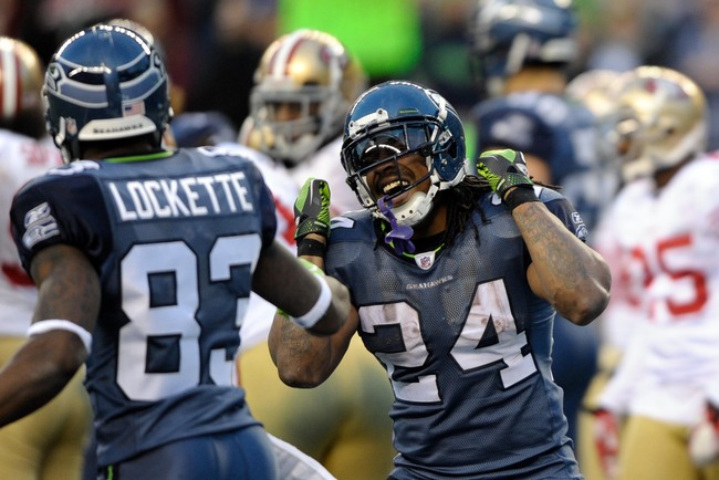 Dec 24, 2011; Seattle, WA, USA; Seattle Seahawks running back Marshawn Lynch (24) celebrates with wide receiver Ricardo Lockette (83) after scoring a touchdown during the 2nd half against the San Francisco 49ers at CenturyLink Field. San Francisco defeate