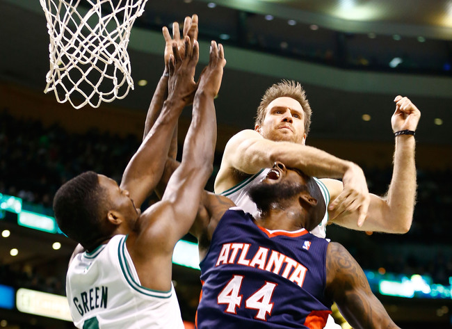 BOSTON, MA - MARCH 29:  van Johnson #44 of the Atlanta Hawks gets hit in the head by Shavlik Randolph #42 of the Boston Celtics during the game on March 29, 2013 at TD Garden in Boston, Massachusetts. NOTE TO USER: User expressly acknowledges and agrees t