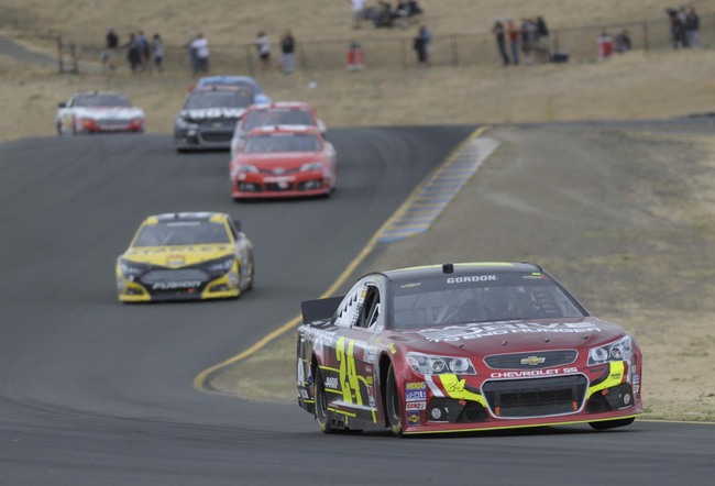 Jun 23, 2013; Sonoma, CA, USA; NASCAR Sprint Cup Series driver Jeff Gordon (24) races through turn eight during the Toyota/Save Mart 350 at Sonoma Raceway. Mandatory Credit: Ed Szczepanski-USA TODAY Sports
