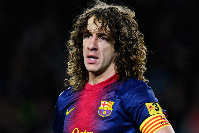 BARCELONA, SPAIN - FEBRUARY 26:  Carles Puyol of FC Barcelona looks on during the Copa del Rey Semi Final second leg between FC Barcelona and Real Madrid at Camp Nou on February 26, 2013 in Barcelona, Spain.  (Photo by David Ramos/Getty Images)