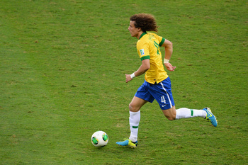 BELO HORIZONTE, BRAZIL - JUNE 26:  David Luiz of Brazil in action during the FIFA Confederations Cup Brazil 2013 Semi Final match between Brazil and Uruguay at Governador Magalhaes Pinto Estadio Mineirao on June 26, 2013 in Belo Horizonte, Brazil.  (Photo