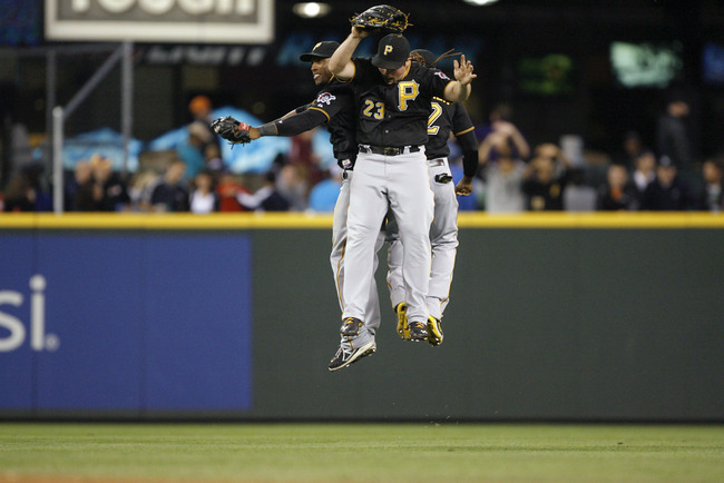 Jun 25, 2013; Seattle, WA, USA; Pittsburgh Pirates left fielder Starling Marte (6, left) and right fielder Travis Snider (23) celebrate a 9-4 victory against the Seattle Mariners at Safeco Field. Mandatory Credit: Joe Nicholson-USA TODAY Sports