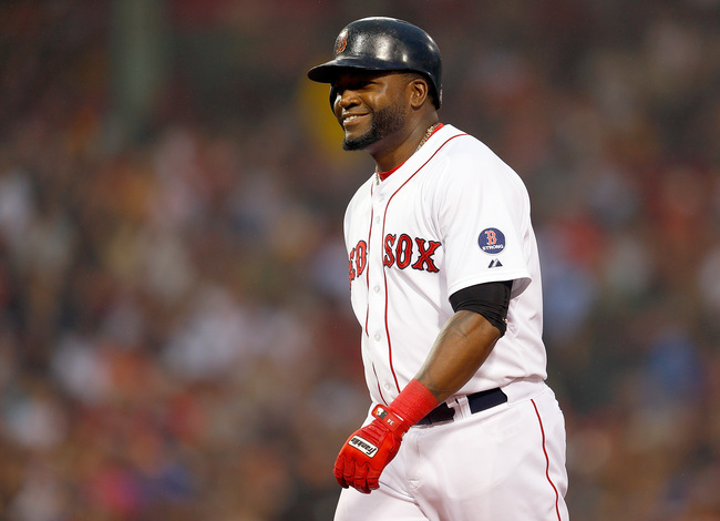 BOSTON, MA - JUNE 27:  David Ortiz #34 of the Boston Red Sox smiles after he singled against the Toronto Blue Jays in the 3rd inning at Fenway Park on June 27, 2013 in Boston, Massachusetts.  (Photo by Jim Rogash/Getty Images)