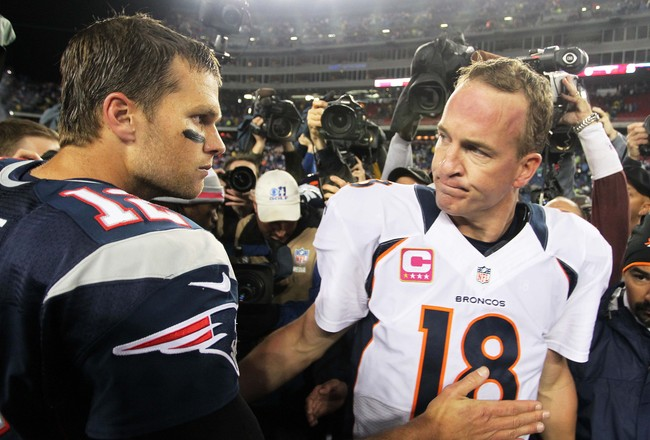 Oct 7, 2012; Foxborough, MA, USA; New England Patriots quarterback Tom Brady (12) shakes hands with Denver Broncos quarterback Peyton Manning (18) following the game at Gillette Stadium. The Patriots defeated the Broncos 31-21. Mandatory Credit: Stew Miln