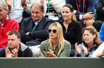 Maria Sharapova watches boyfriend, Grigor Dimitrov, after losing in the second round.