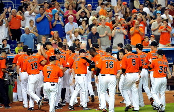 The Miami Marlins walk back to the dugout to a standing ovation thanks to Jeff Mathis' walk-off grand slam Sunday.