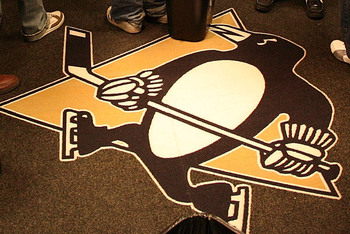 PITTSBURGH - MAY 20:  The unwritten rule of not standing on the team's logo is followed by the media after the Pittsburgh Penguins practice at the Mellon Arena on May 20, 2009 in Pittsburgh, Pennsylvania.  (Photo by Bruce Bennett/Getty Images)