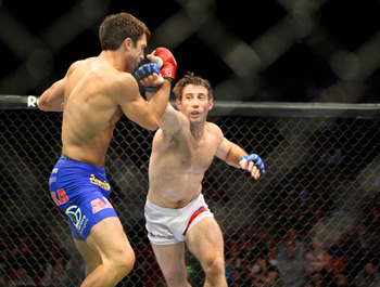 Tim Kennedy swinging at Luke Rockhold during a Strikeforce title fight.