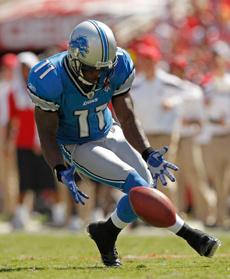 TAMPA, FL - SEPTEMBER 11:  Stefan Logan #11 of the Detroit Lions picks up the ball after dropping it on a punt return during the season opener against the Tampa Bay Buccaneers at Raymond James Stadium on September 11, 2011 in Tampa, Florida.  (Photo by Mi