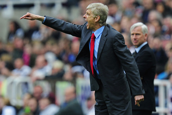NEWCASTLE UPON TYNE, ENGLAND - MAY 19:  Managers Arsene Wenger (L) of Arsenal issues instructions to his players as Alan Pardew of Newcastle looks on during the Barclays Premier League match between Newcastle United and Arsenal at St James' Park on May 19