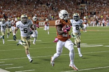 Johnson using his awesome speed to coast for an 84-yard touchdown against Baylor. (Tom Reel/Express-News)