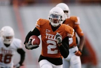 Sanders taking off for a score in Texas' spring game. (Lawrence Peart/Daily Texan)