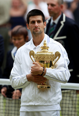LONDON, ENGLAND - JULY 03:  Novak Djokovic of Serbia holds the championship trophy after winning his final round Gentlemen's match against Rafael Nadal of Spain on Day Thirteen of the Wimbledon Lawn Tennis Championships at the All England Lawn Tennis and