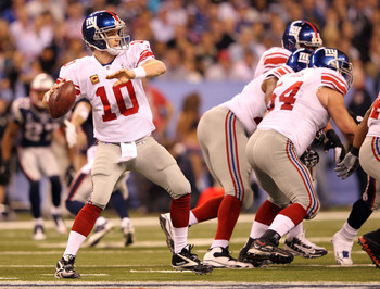 QB Eli Manning looks downfield during Super Bowl XLVI.