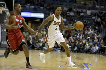 MILWAUKEE, WI - APRIL 25: Brandon Jennings #3 the Miami Heat dribbles around the perimeter with Mario Chalmers #15 of the Milwaukee Bucks guarding during Game Three of the Western Conference Quarterfinals of the 2013 NBA Playoffs at Bradley Center on APRI