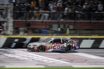 Kevin Harvick survived a wild Coca Cola 600 to take the win.