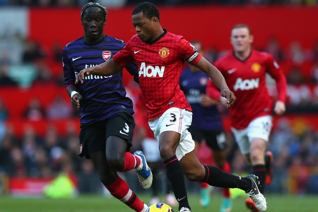 MANCHESTER, ENGLAND - NOVEMBER 03:  Patrice Evra of Manchester United competes with Bacary Sagna of Arsenal during the Barclays Premier League match between Manchester United and Arsenal at Old Trafford on November 3, 2012 in Manchester, England. (Photo b