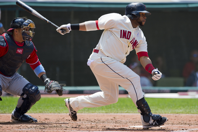 CLEVELAND, OH - JUNE 16: Carlos Santana #41 of the Cleveland Indians hits an RBI single during the fourth inning against the Washington Nationals at Progressive Field on June 16, 2013 in Cleveland, Ohio. (Photo by Jason Miller/Getty Images)