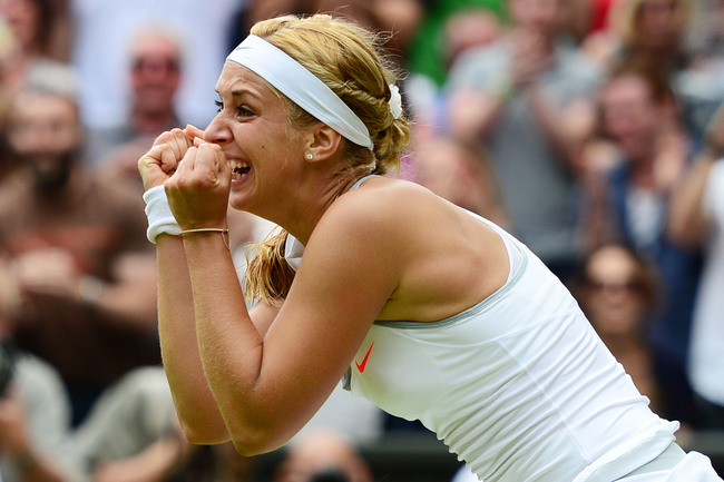 LONDON, ENGLAND - JULY 01:  Sabine Lisicki of Germany celebrates match point during her Ladies' Singles fourth round match against Serena Williams of United States of America on day seven of the Wimbledon Lawn Tennis Championships at the All England Lawn