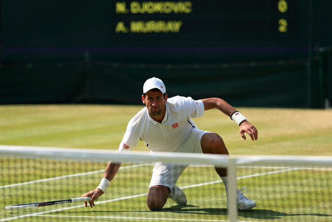 LONDON, ENGLAND - JULY 07:  Novak Djokovic of Serbia watches the ball after returning a shot during the Gentlemen's Singles Final match against Andy Murray of Great Britain on day thirteen of the Wimbledon Lawn Tennis Championships at the All England Lawn
