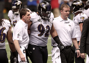 NEW ORLEANS, LA - FEBRUARY 03:  Haloti Ngata #92 of the Baltimore Ravens walks off of the field with medical staff of the Ravens against the San Francisco 49ers during Super Bowl XLVII at the Mercedes-Benz Superdome on February 3, 2013 in New Orleans, Lou