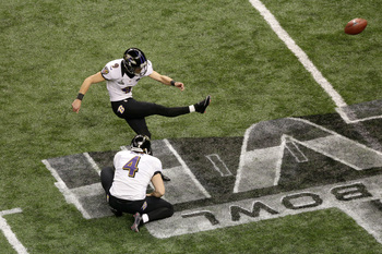 NEW ORLEANS, LA - FEBRUARY 03:  Justin Tucker #9 of the Baltimore Ravens attempts a kick from the hold of Sam Koch #4 against the San Francisco 49ers during Super Bowl XLVII at the Mercedes-Benz Superdome on February 3, 2013 in New Orleans, Louisiana.  (P