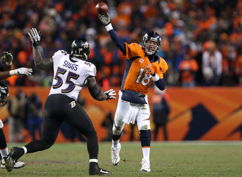 DENVER, CO - JANUARY 12:  Peyton Manning #18 of the Denver Broncos throws a pass in in the fourth quarter against Terrell Suggs #55 of the Baltimore Ravens during the AFC Divisional Playoff Game at Sports Authority Field at Mile High on January 12, 2013 i
