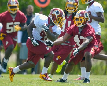 During Redskins rookie camp, linebacker Jeremy Kimbrough faces off with rookie RB Jawan Jamison.  PHOTO CREDIT:  John McDonnell/The Washington Post