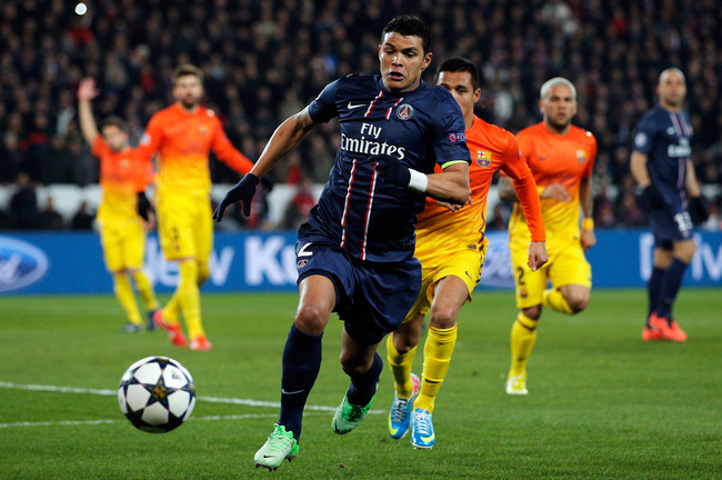 PARIS, FRANCE - APRIL 02:  Thiago Silva of PSG and Alexis Sanchez of Barcelona chase the ball mduring the UEFA Champions League Quarter Final match between Paris Saint-Germain and Barcelona FCB at Parc des Princes on April 2, 2013 in Paris, France.  (Phot