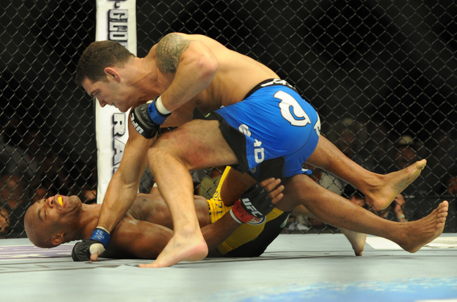 Jul 6, 2013; Las Vegas, NV, USA;  Chris Weidman, blue shorts, defeated Anderson Silva (yellow shorts) in their Middleweight Chamionship Bout in the second round with a TKO at the MGM Grand Garden Arena. Mandatory Credit: Jayne Kamin-Oncea-USA TODAY Sports