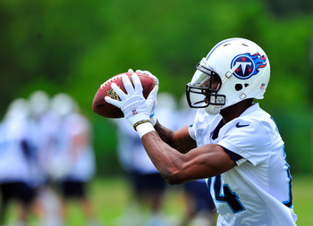 Jun 18, 2013; Nashville, TN, USA; Tennessee Titans wide receiver Michael Preston (14) catches a pass during mini camp at Baptist Sports Park. Mandatory Credit: Jim Brown-USA TODAY Sports