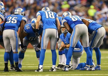 Will Matthew Stafford (in the huddle) once again carry the burden of the Lions offense?