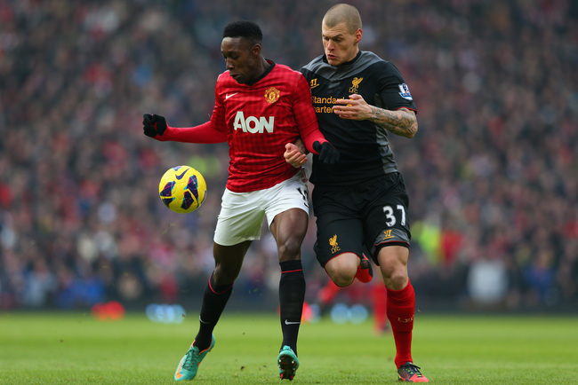 MANCHESTER, ENGLAND - JANUARY 13:  Martin Skrtel of Liverpool competes with Danny Welbeck of Manchester United during the Barclays Premier League match between Manchester United and Liverpool at Old Trafford on January 13, 2013 in Manchester, England. (Ph