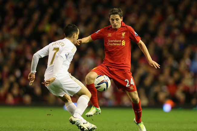LIVERPOOL, ENGLAND - OCTOBER 31:  Joe Allen of Liverpool competes with Leon Britton of Swansea City during the Capital One Cup Fourth Round match between Liverpool and Swansea City at Anfield on October 31, 2012 in Liverpool, England.  (Photo by Clive Bru