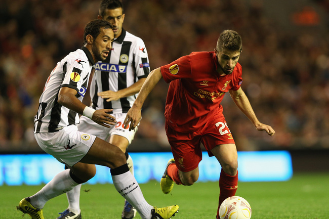 LIVERPOOL, ENGLAND - OCTOBER 04:  Fabio Borini of Liverpool competes with Medhi Benatia of Udinese Calcio during the UEFA Europa League Group A match between Liverpool and Udinese at Anfield on October 4, 2012 in Liverpool, England. (Photo by Clive Brunsk