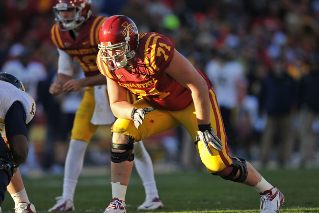 Nov 23, 2012; Ames, Iowa, USA; Iowa State Cyclones offensive tackle Carter Bykowski (71) gets set on the line against the West Virginia Mountaineers during the first half at Jack Trice Stadium.  Mandatory Credit: Peter G. Aiken-USA TODAY Sports