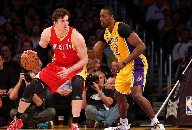 LOS ANGELES, CA - APRIL 17:  Omer Asik #3 of the Houston Rockets controls the ball against Dwight Howard #12 of the Los Angeles Lakers at Staples Center on April 17, 2013 in Los Angeles, California. NOTE TO USER: User expressly acknowledges and agrees tha